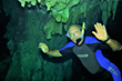 Author Paul Mila explores a cenote researching his new novel