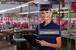Shop floor employee with tablet and face check software