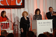 Patricia Heaton, left, presents Open Hearts award to Exceptional Minds co-founders Ernie Merlán, Yudi Bennett and Susan Zwerman.