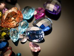 Joseph Menzie Inc. Colored gemstone sales, emeralds, rubies, sapphires and other precious gems. Lapidary and estate jewelry appraisals.