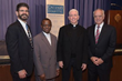 Fr. Beck (2nd from right) pictured with Calvary staff (left to right), Michael Troncone, Vice President of Human Resources, Fr. Chux Okochi, Director of Pastoral Care, and Frank Calamari, CEO.