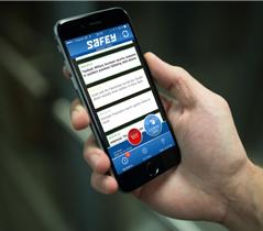 Handheld smartphone featuring SAFEY app on screen over a dark green background