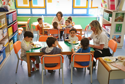 Young Children Eating a Healthy Lunch in an Early Education Classroom