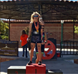 Michelle Erin Ray placing 1st Place for Overall Female at The Pumpkinman Triathlon awards ceremony.