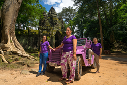 A photo of the Lavender Jeep Siem Reap Team with their A2 Military Jeep parked in the Angkor Thom complex