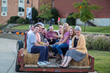 FHU President David Shannon and members of his staff join students for a hayride during the celebratory picnic Thursday, Oct. 19, 2017.