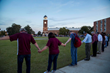 FHU President David R. Shannon and his wife, Tracie, join hands with students, board of trustee members and friends for prayer at the celebratory picnic after the inauguration Thursday, Oct. 19, 2017.