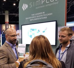 Mike Lockert, Executive V.P. of Sales for Simplus, left, and Jake Boyd, CPQ trainer, right, talk with a Dreamforce attendee during the 2017 convention in San Francisco.