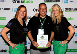 Caption: Cruise Planners® franchise owner, Michael Consoli, receiving #1 River Cruise Agent from Michelle Fee & Vicky Garcia, one of 6 awards Michael received this year.