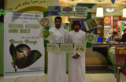 Students from the University of Buraimi, Oman, promote awareness of how to fight climate change in a local supermarket