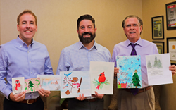 New Perspective Senior Living officers with winning Christmas Card Contest artwork