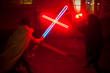 """James Akers and Lily Reeves, """"Neon Sword Fight,"""" 2015. Neon, argon, wood. Photo by Charlie Golonkiewicz."""