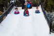 Snow Wonder transforms Marina del Rey's Burton Chace Park into a winter wonderland with 80 tons of real snow used to create a sledding hill and snow-kissed pine forest.