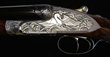 "Holland & Holland ""Royal"" Hammerless Ejector 12 Gauge Masterpiece Shotgun, with Multi-Colored Gold Inlaid High Relief by Rashid El Hadi, Sold For $120,750."