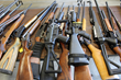 Several of the hundreds of rifles and shotguns ready for destruction