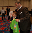 World's Youngest Motivational Speaker Gives Back With BE AMAZING Book On Stage with Les Brown, John Travolta, Mark Wahlberg, Mel Gibson, Christie Brinkley & Steve Wozniak
