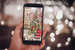Mobile merchandising app takes picture of retail Christmas display