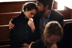 couple consoling each other at a funeral