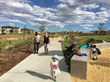 """Play Pods"" accentuate the arcing walkway that divides the native drainage way and the large turf field through Cottonwood Gallery, one of the recently opened Civitas-designed parks at Denver's Staple"