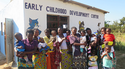 Mothers and Children in front of an Early Childhood Development Center in Zambia