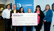 CEO Eric Loeffel (left) and brand leader Doug Smidley (left center), along with two other NewPoint employees donate check to the American Cancer Society