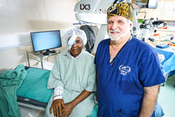 Mercy Ships surgeon Dr. Glenn Strauss with the 30,000th surgery patient onboard the Africa Mercy hospital ship