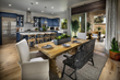Image of kitchen dining room and outdoor space of Residence 3 a new home built by McCaffrey Homes in the Ivy at Riverstone community in Madera CA