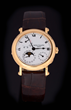 Patek Philippe 18k Power Reserve Moonphase Wristwatch Model # 5054, estimated at $10,000-20,000.