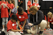 W.O. Lance Elementary students from Lanett City Schools prepare to launch their JetToy as KMMG volunteer Joy Johnston provides instruction.