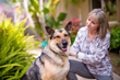Kathleen Newhouse with her service dog Jackamo.