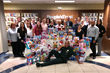 People's Trust Insurance Teams up with The Broward Sheriff's Office to Donate Toys to Women In Distress