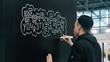 Timothy Goodman creating art at BDNY 2017 with BERMANFALK.
