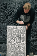 Timothy Goodman works on a custom casegood manufactured by BERMANFALK.