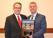 Todd Varney, NexCore's Managing Principal (right), accepts the HREI Insights Award from HREI Publisher Murray W. Wolf a Dec. 7 luncheon attended by 300 industry peers in Scottsdale, Ariz.