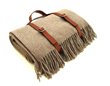 A wool and cashmere throw that comes with a leather carrier by Katrin Leuze makes a sumptuously cozy gift for him or her this holiday as recommended by WRJ Design.