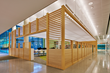 The distinctive pavilion in the children's area defines the space while creating a sense of warmth and scale with the wood structure that wraps around it.