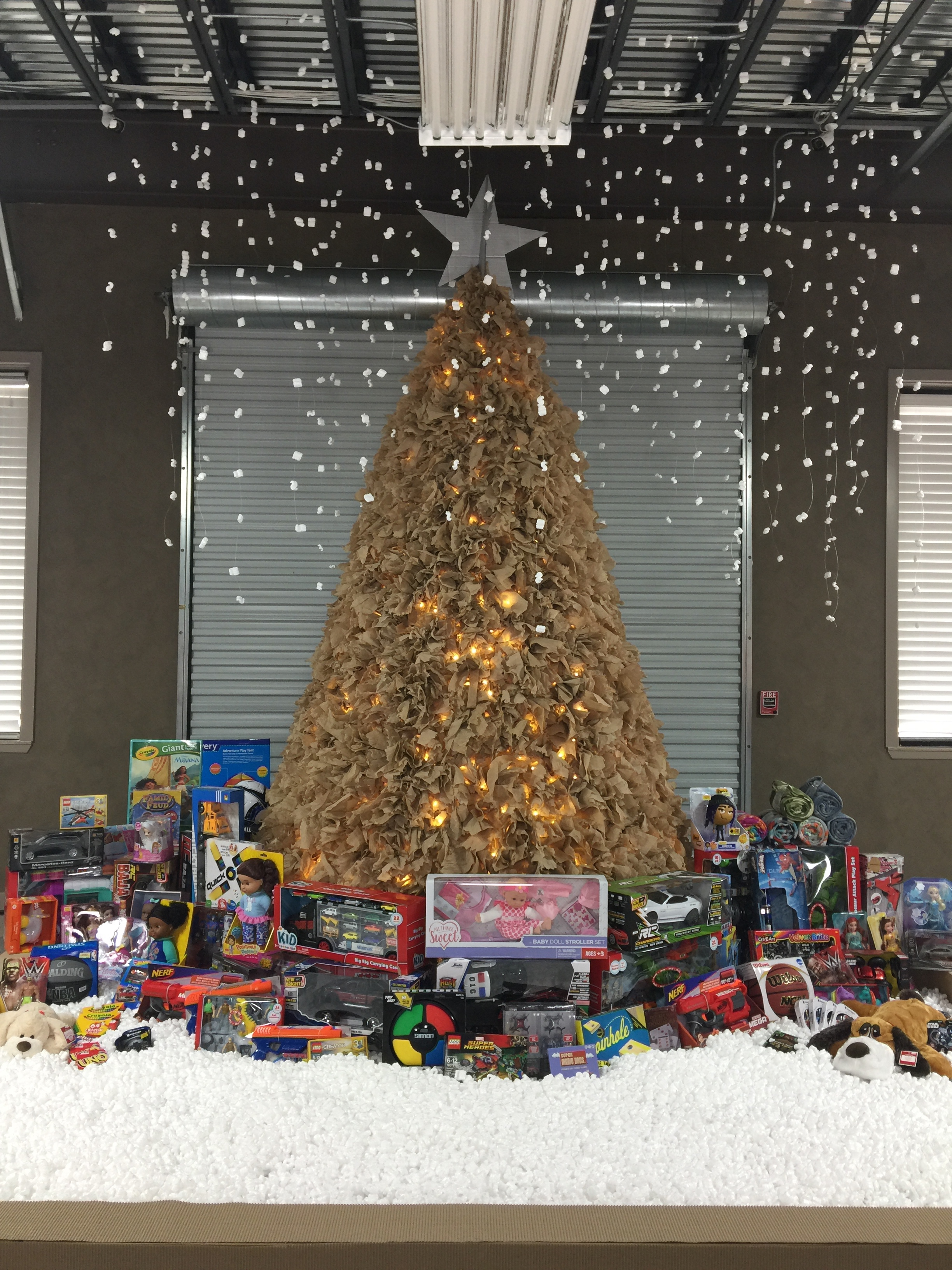 ameritex movers shows its holiday spirit with cardboard christmas tree and toy drive