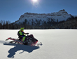 Guests of Brooks Lake Lodge & Spa can enjoy a variety of included winter activities such as snowmobiling around the nearly two million acres of snowy and scenic terrain.