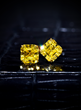 A Pair of 2.02ct Fancy Vivid Yellow Diamond Ear Studs, achieved $87,500 at auction.