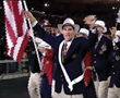 Team USA Flag Bearer Cliff Meidl leads the US Delegation at the Sydney 2000 Olympic Games.