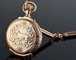 Elgin 14K Gold Pocket Watch & Gold Quartz Chain, Estimated at $6,000-10,000.