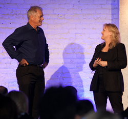 Picture of Tim Costello CEO and Melissa Morman Chief Client Officer of Builders Digital Experience (BDX) Speaking at a Conference