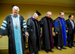 Gardner (center) prays along with former FHU President Milton Sewell and David Shannon before his inauguration Oct. 19, 2017.
