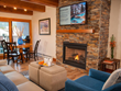 New electronics in Antlers at Vail hotel's Platinum-ranked guest suites include large flat-screen TVS for watching March Madness basketball action combined with a cozy fire in the fireplace.