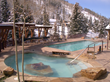 One of Antlers at Vail hotel's numerous complimentary amenities, the year-round pool boasts a view of Vail slopes and two steaming hot tubs.