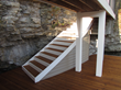 Witt's Woods & Greens engineered a boat dock into the natural setting of a rocky cliff.