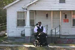 Willard Swinson outside of his home
