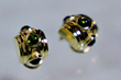 Small earrings with 18K gold and chrome diopside. Photo by Alan Brodsky