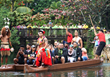 Inducees ride the canoe after the enshrinement ceremony