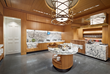 The 500 SF servery features warm, glowing millwork and meticulously concealed food service equipment.